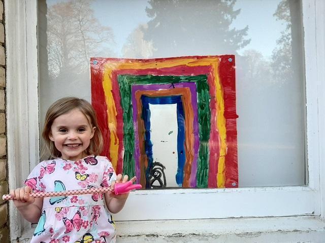 MM (Ocelot) with an amazing rainbow in her window 🌈