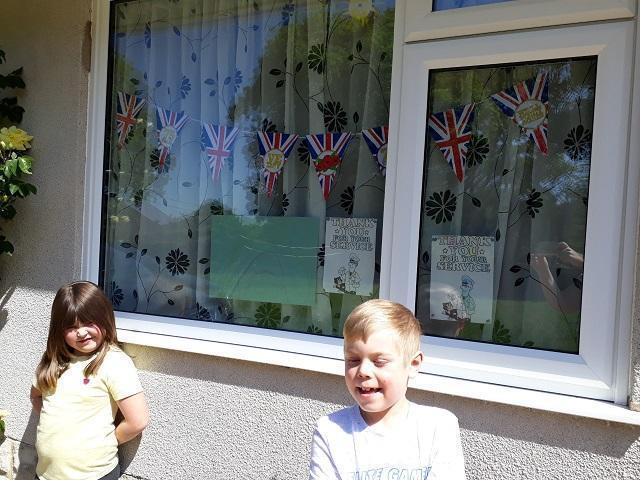 PW (Lynx) & JW (Puma) with their VE day window