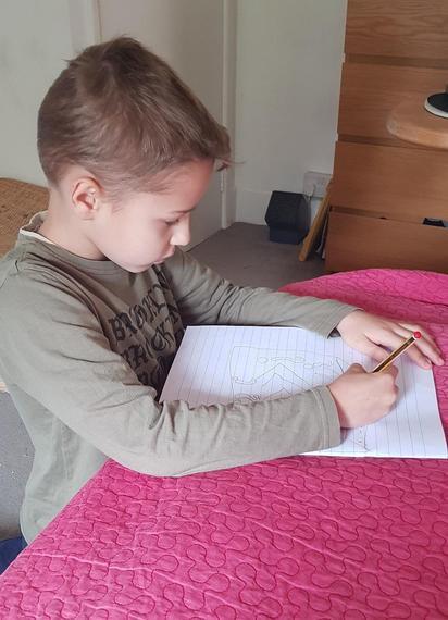 BM (Puma) working hard on his schoolwork