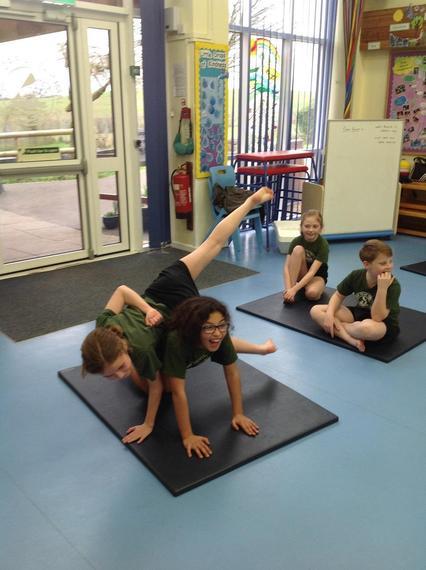 Snow Leopard Class learning gymnastics