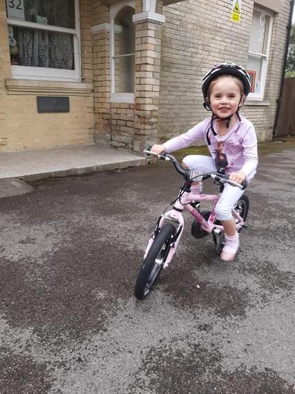 MM (Ocelot) learns to ride her bike