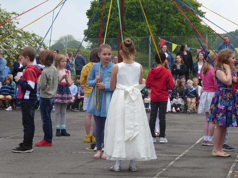 Maypole dancing at the Fayre