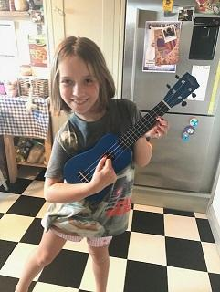MB has started to learn the ukulele with her Dad