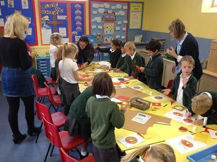 Working with the children to create card designs.