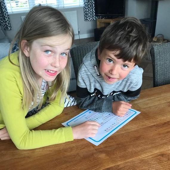 EP (Puma) helps her brother with phonics