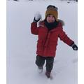 Watch out Mum, he has a snowball!