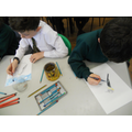 Mrs Bottomley's class working on their paintings