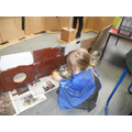 Reception children painting the Endeavour