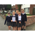 Year 6 delivering invitations to our neighbour