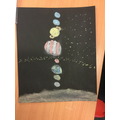 We have designed an art piece with stark colours to represent space.