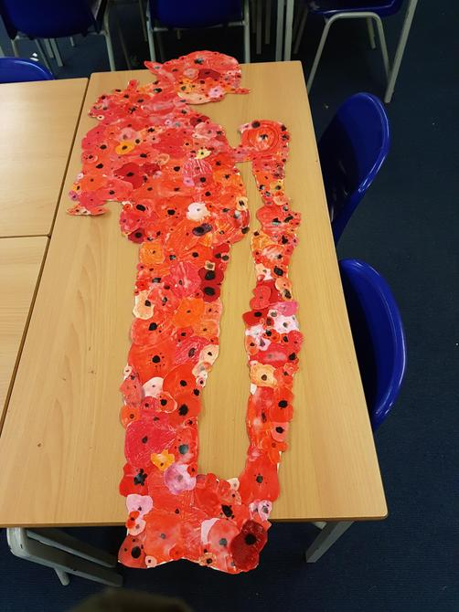 Creating our soldier from over 100 poppies!