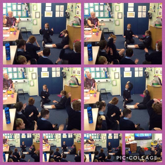 Year 5 Learning how to sign the hymn.