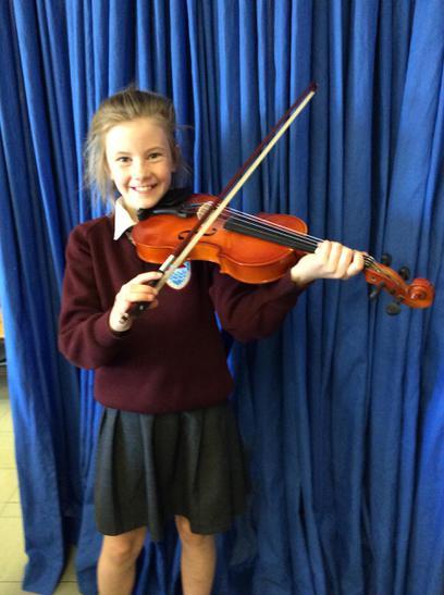Cara Quinn achieved Grade 1 in her violin exam