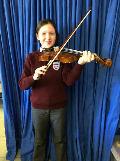 Emma Doran achieved Grade 1 in her violin exam
