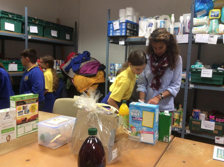 The children helped to sort food parcels