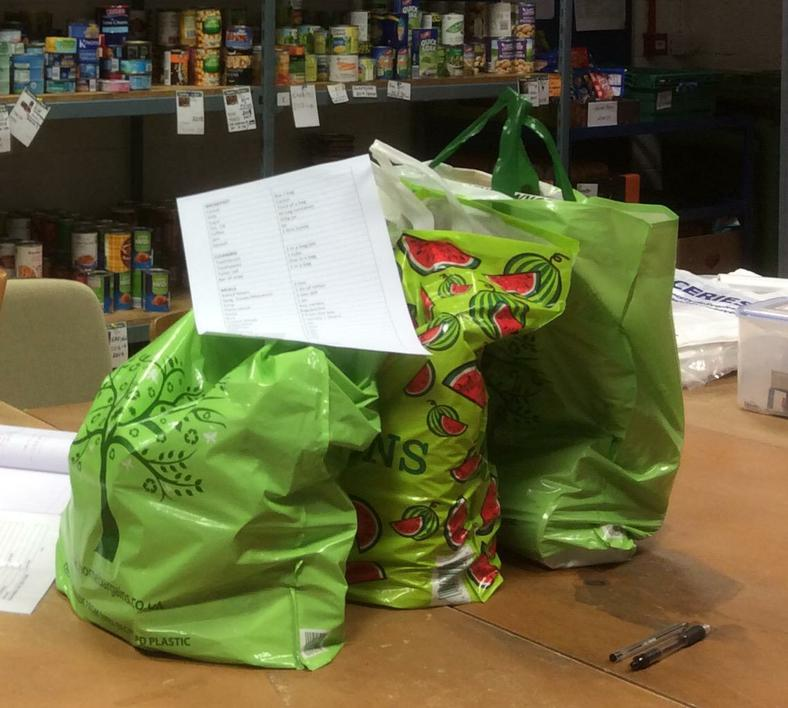 ... and helped to make up food bags.