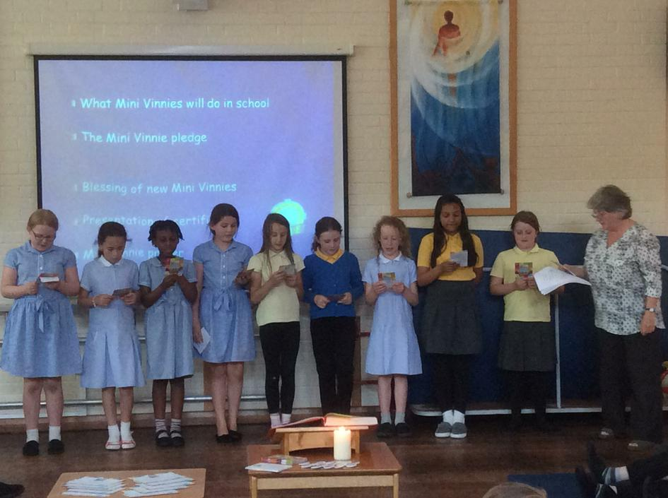 The new Mini Vinnies recite their pledge.