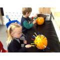Hammering golf tees into pumpkins