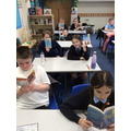 Year 5/6 enjoying their free World Book Day books