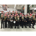 Carol singing at Sainsburys