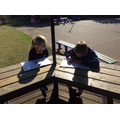 Interviewing each other for our newspaper reports.