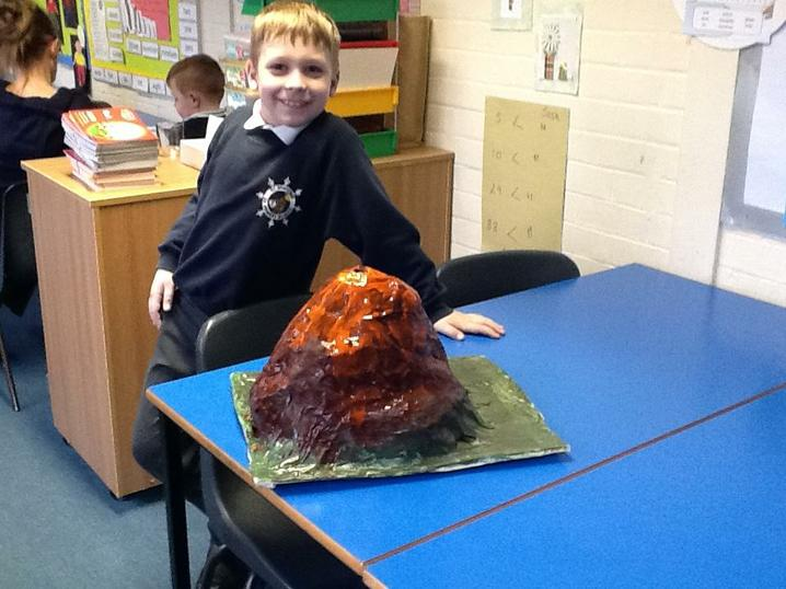 The children helped paint a papermache volcano!
