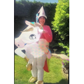 Mrs Doe dressed up riding 'The Secret Unicorn' from the book by Linda Chapman