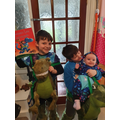 Yr5 and Yr4 and little sister all dressed as Dinosaurs in Pants