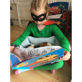 Year 3 Evil Pea reading to her guinea pig Snitch