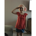 Lilah saluting VE Day in red and blue