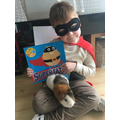 Year 1 Supertato reading to his guinea pig Snitch