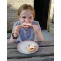 Maisie enjoying her cream tea at home on VE Day