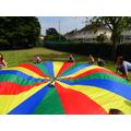 Children and staff enjoying parachute games