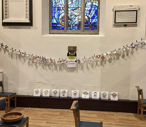 Year 1 children decorate Church with angels at Christmas