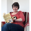 Mrs Ross sharing story with furry friend