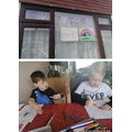 Sebastian and Lucas busy making their own bunting