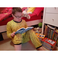 Y4 Reading one of favourite Wimpy Kid books