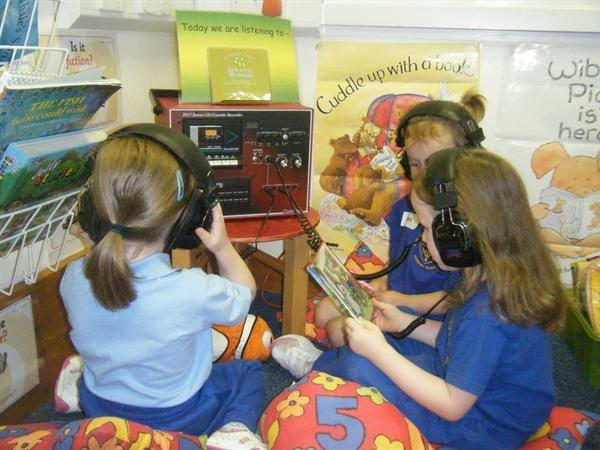 Sharing stories on the listening centre.