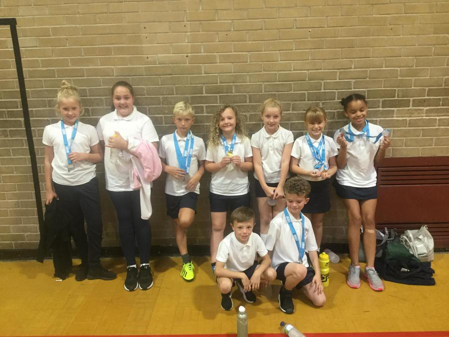 Personal best team with their medals.