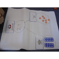 Using numicon to partition numbers.