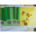 Using manipulatives to learn about money.