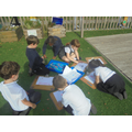 Imroving our playground - colouring in area.