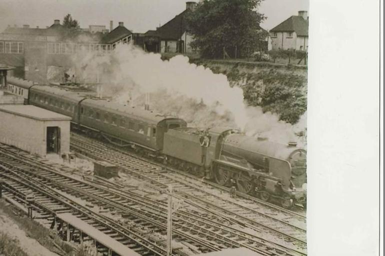 Steam train passing through Swanley 1960's