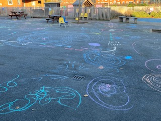 We drew lots of firework patterns on our playground with chalk