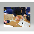 Designing parachutes to test air resistance in Science