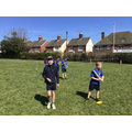 Playing rounders in P.E.
