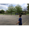Practising tennis skills in P.E.