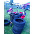 Team work to make a tall tower of tyres.