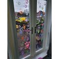 Aiyra's rainbow handprint window
