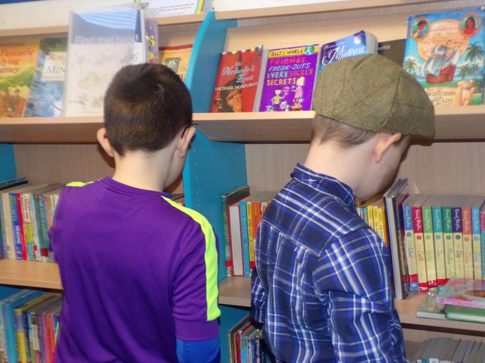 Choosing our library books.